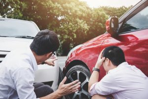 Two drivers man arguing after a car traffic accident collision, Traffic Accident and insurance concept.